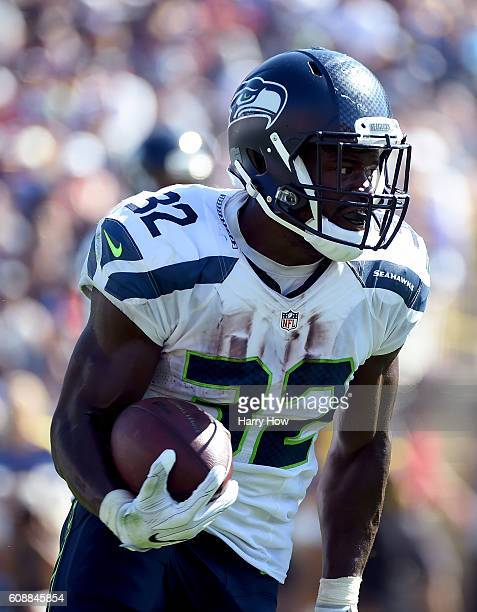 Christine Michael of the Seattle Seahawks carries the ball during the home opening NFL game between the Los Angeles Rams and the Seattle Seahawks at...