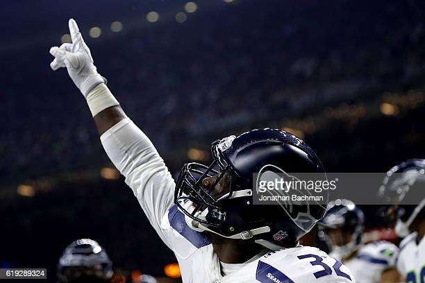 Christine Michael of the Seattle Seahawks celebrates a touchdown during the first half of a game against the New Orleans Saints at the MercedesBenz...
