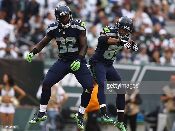 Christine Michael of the Seattle Seahawks celebrates his fourth quarter touchdown with teammate Doug Baldwin against the New York Jets at MetLife...