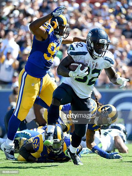 Christine Michael of the Seattle Seahawks eludes tacklers as carries the ball during the third quarter of the home opening NFL game against the Los...