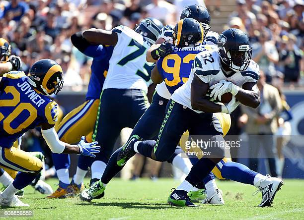 Christine Michael of the Seattle Seahawks protects the ball on a rush during the second quarter of the home opening NFL game between the Los Angeles...