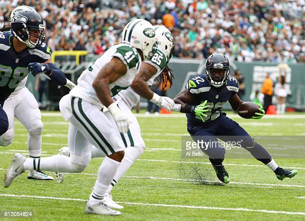 Christine Michael of the Seattle Seahawks runs against Buster Skrine and Calvin Pryor of the New York Jets during their game at MetLife Stadium on...
