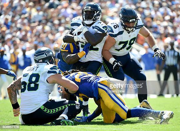 Christine Michael of the Seattle Seahawks runs as he is tackled by Dominique Easley of the Los Angeles Rams during the second quarter of the home...