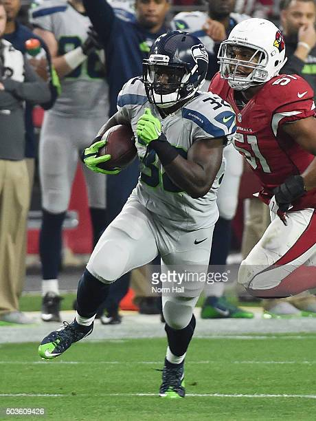 Christine Michael of the Seattle Seahawks runs with the ball against the Arizona Cardinals at University of Phoenix Stadium on January 3 2016 in...