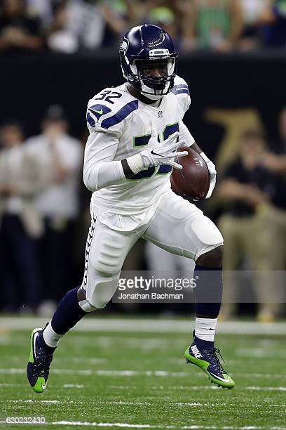 Christine Michael of the Seattle Seahawks runs with the ball during a game against the New Orleans Saints at the MercedesBenz Superdome on October 30...