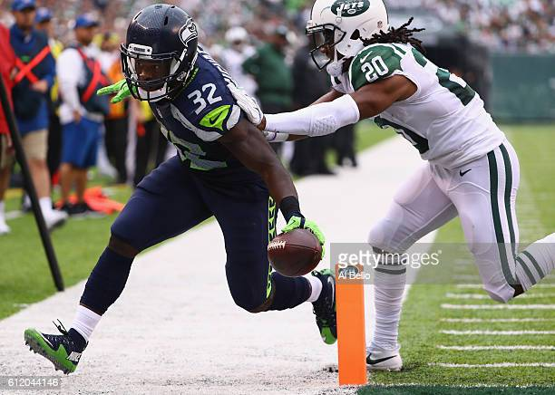 Christine Michael of the Seattle Seahawks scores a touchdown against Marcus Williams of the New York Jets in the fourth quarter at MetLife Stadium on...