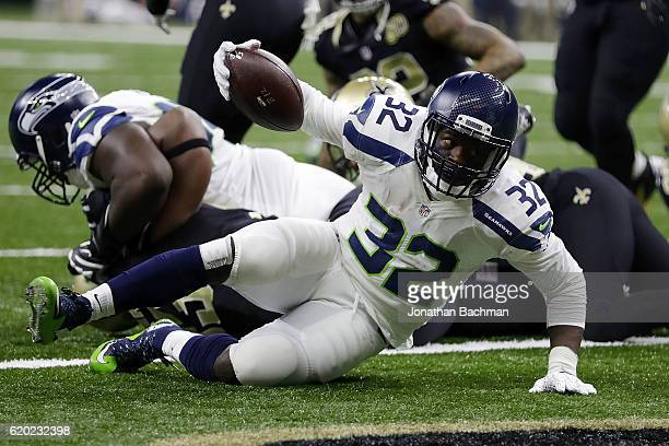 Christine Michael of the Seattle Seahawks scores a touchdown during a game against the New Orleans Saints at the MercedesBenz Superdome on October 30...