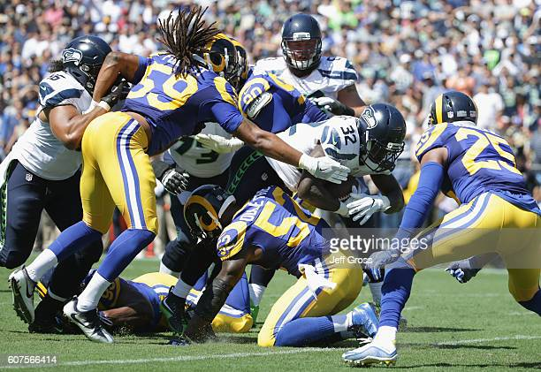 Christine Michael of the Seattle Seahawks tries to get through the Los Angeles Rams defense during the second quarter of the home opening NFL game at...