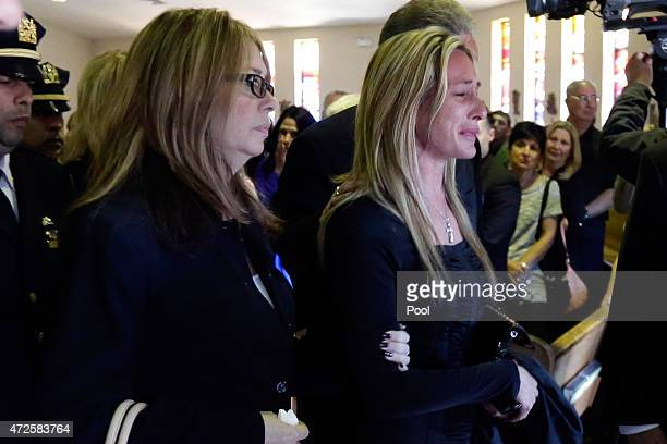 Christine Moore sister of New York City Police officer Brian Moore leaves the funeral for her brother at the Saint James Roman Catholic Church on May...