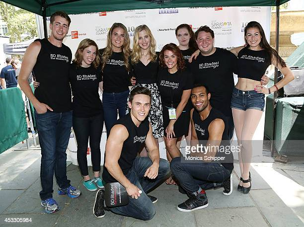 Christine Nagy of 1067 Lite FM poses for a photo with cast members from Õ50 Shades The MusicalÕ at 1067 LITE FM's Broadway in Bryant Park 2014 at...