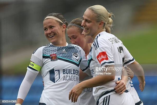 Christine Nairn, Laura Spiranovic and Natasha Dowie of Melbourne Victory celebrate a goal by Natasha Dowie during the round seven W-League match...