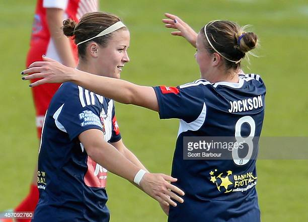 Christine Nairn of Melbourne is congratulated by Amy Jackson after scoring the first goal during the round five W-League match between Melbourne and...