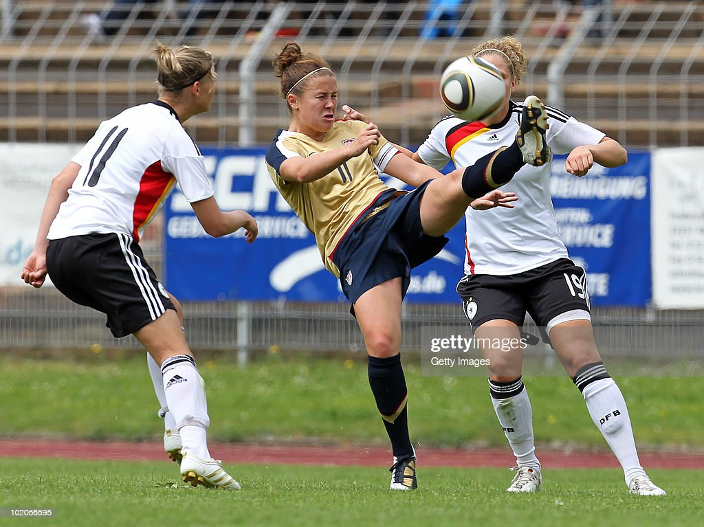 Christine Nairn (C) of USA challenges Alexandra Popp (L) and Kim Kuhlig (R) of Germany during the DFB women's U20 match between Germany and USA at the Ludwig-Jahn-Stadion on June 13 2010 in Herford, Gerrmany.