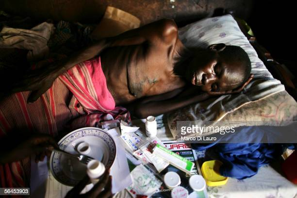 Christine Nakato who is suffering from an infection as a consequence of being HIV positive rests in her bed as a Community ARV and TB treatment...