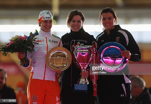 Christine Nesbitt of Canada for first place Heather Richardson of USA for second place and Marrit Leenstra of Netherlands for third place celebrate...