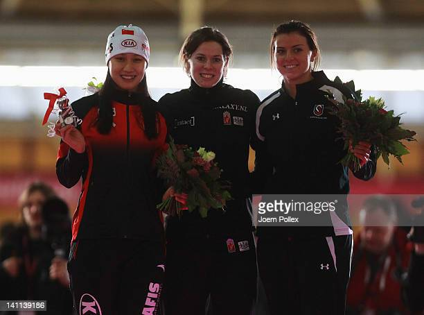 Christine Nesbitt of Canada for first place Heather Richardson of USA for second place and Hong Zhang of China for third place celebrate on the...