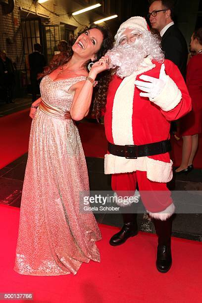 Christine Neubauer and a Santa Claus actor attend the Ein Herz Fuer Kinder Gala 2015 reception at Tempelhof Airport on December 5 2015 in Berlin...