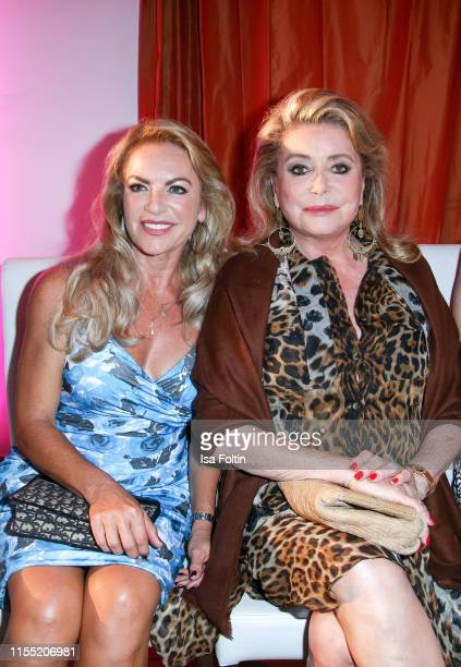 Christine Neubauer and Catherine Deneuve during the Ernsting's family Fashion Show 2019 on July 11, 2019 in Hamburg, Germany.