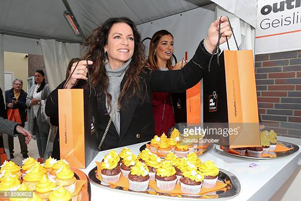 Christine Neubauer and Jana Ina Zarella sell charity bags during the opening of the City Outlet Geislingen on October 27 2016 in Geislingen Germany