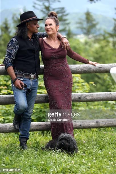 "Christine Neubauer and Jose Campos pose with their dog Gismol during the ""Watzmann ermittelt"" photocall for ""Die verkaufte Braut"" on June 8, 2021 at..."