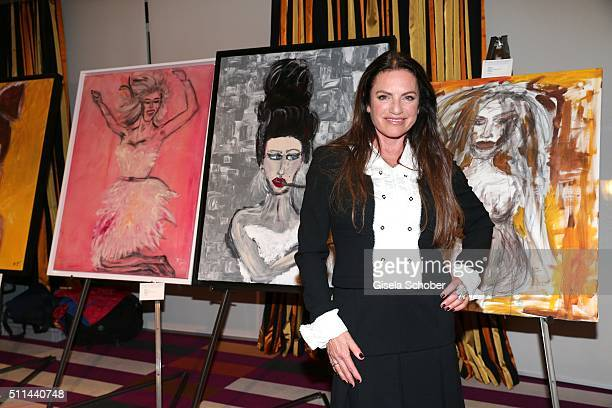 Christine Neubauer in front of her paintings during the 'Christine Neubauer Hautnah' exhibition opening at Hotel Vier Jahreszeiten on February 20...