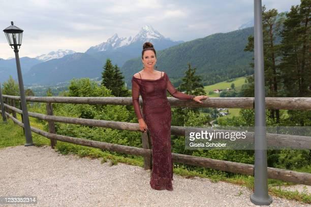 """Christine Neubauer poses during the 3rd season """"Watzmann ermittelt"""" photocall for """"Die verkaufte Braut"""" on June 8, 2021 at Kastensteinerwand Alm in..."""