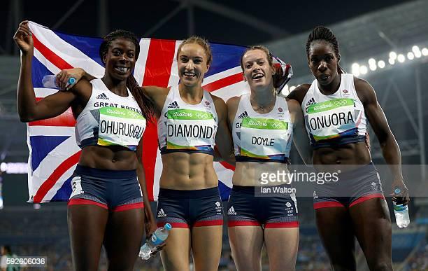 Christine Ohuruogu Emily Diamond Eilidh Doyle and Anyika Onuora of Great Britain react after winning bronze in the Women's 4 x 400 meter Relay on Day...