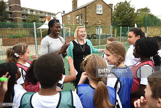 Christine Ohuruogu MBE joins Woodhill Primary School in Woolwich to celebrate the opening of its new multiuse sports facility on October 15 2014 in...