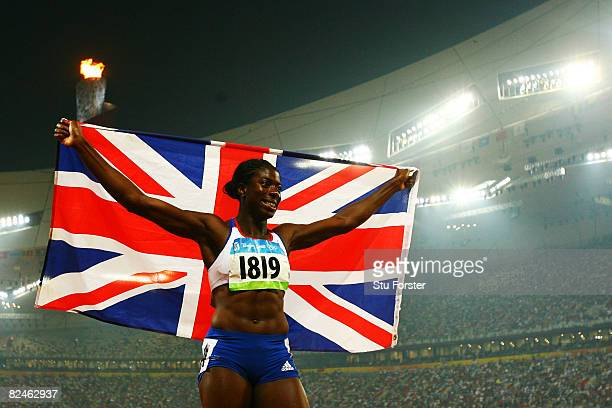 Christine Ohuruogu of Great Britain celebrates winning the Women's 400m Final and the gold medal held at the National Stadium on Day 11 of the...