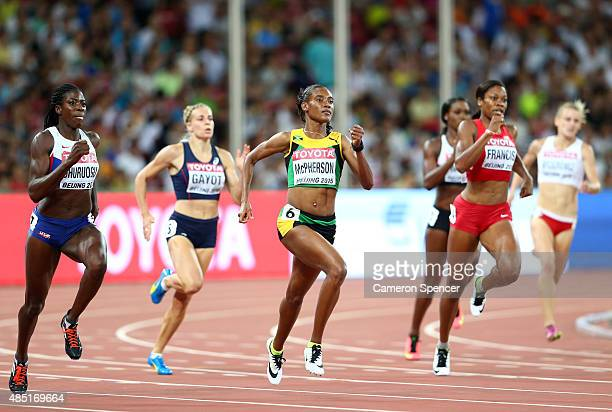 Christine Ohuruogu of Great Britain, Stephenie Ann McPherson of Jamaica and Phyllis Francis of the United States compete in the Women's 400 metres...
