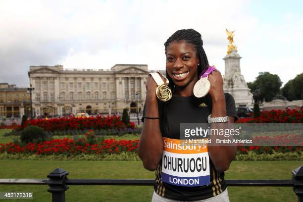 Christine Ohuruogu poses for pictures during a photo call to promote the Sainsbury's Anniversary Games at the Mall on July 15 2014 in London England...
