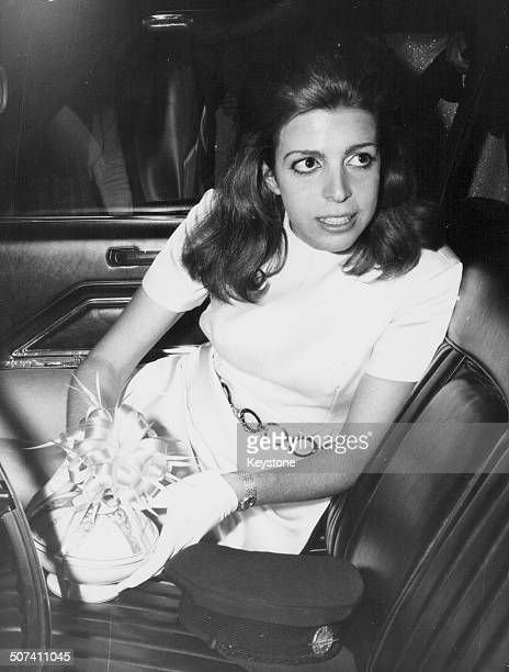 Christine Onassis daughter of ship owner Aristotle in the back of a car attending the wedding of a friend in Athens November 24th 1969