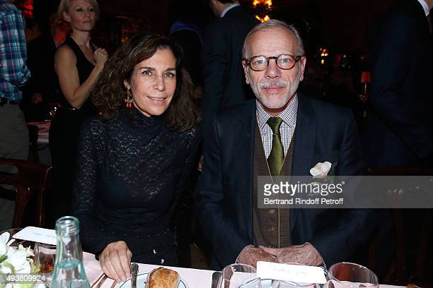 Christine Orban and Actor Pascal Greggory attend the Dinner in honor of the Artist Adrian Ghenie organized by Thaddaeus Ropac at Maxim's on October...