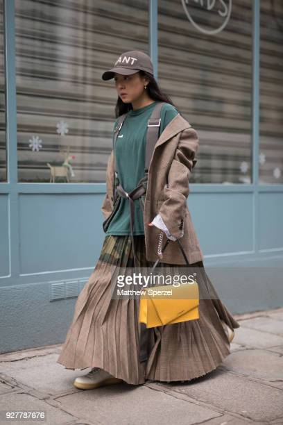Christine Paik is seen on the street attending Sacai during Paris Women's Fashion Week A/W 2018 wearing Sacai with yellow bag on March 5 2018 in...