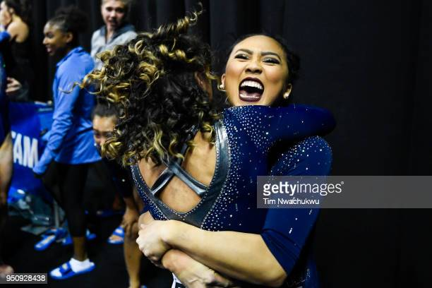 Christine PengPeng Lee embraces teammate Katelyn Ohashi during the Division I Women's Gymnastics Championship held at Chaifetz Arena on April 21 2018...