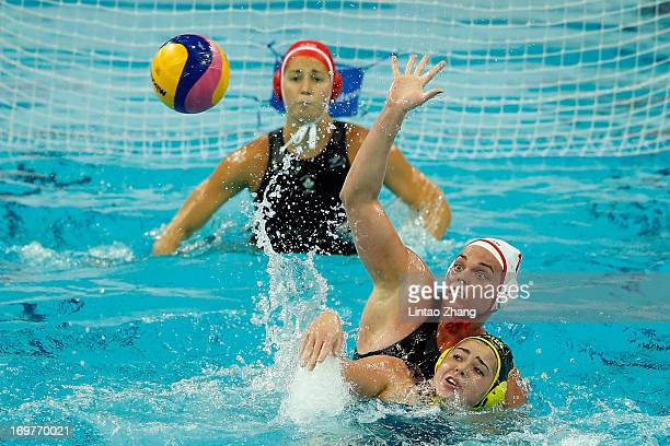 Christine Robinson of Canada challenges Hannah Buckling of Australia in the FINA Women's World League Super Final 2013 round match between Australia...