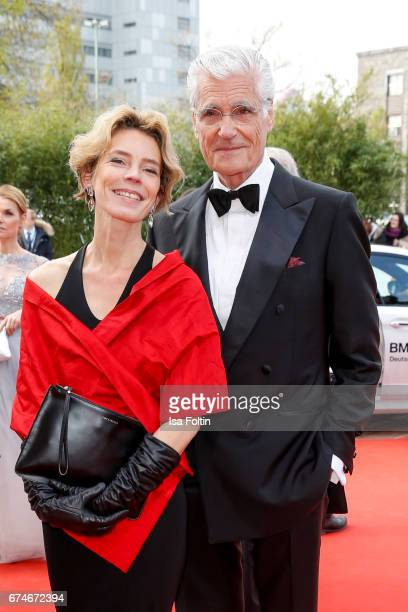 Christine Schuetze and Sky du Mont during the Lola German Film Award red carpet arrivals at Messe Berlin on April 28 2017 in Berlin Germany