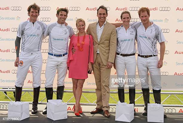 Christine Sieg and Andre Konsbruck Director of Audi UK pose with members of winning Team Ultra Luke Tomlinson Malcolm Borwick Nina Clarkin and Prince...