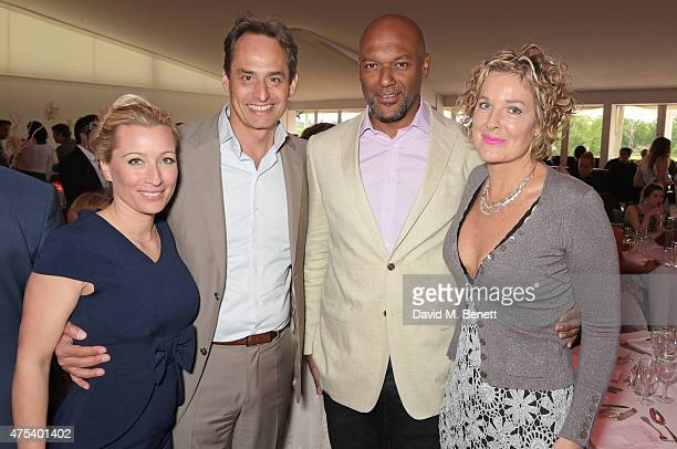 Christine Sieg Andre Konsbruck Director of Audi UK Colin Salmon and Fiona Hawthorne attend day two of the Audi Polo Challenge at Coworth Park on May...