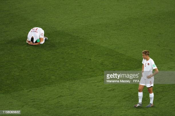 Christine Sinclair and Rebecca Quinn of Canada look dejected following their sides defeat in the 2019 FIFA Women's World Cup France Round Of 16 match...