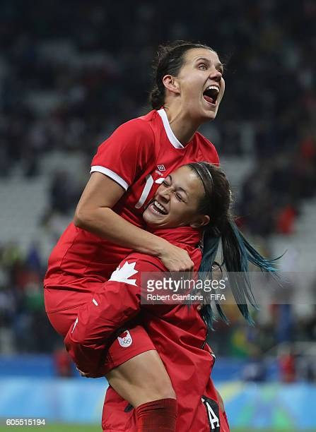 Christine Sinclair and Sabrina D'Angelo of Canada celebrate after canada defeated France during the Women's Football Quarter Final match between...