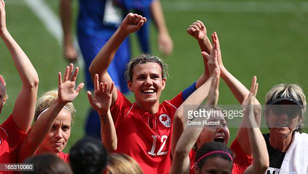 Christine Sinclair celebrates with the team as Canada wins the bronze medal beating France 10 inthe bronze medal soccer match at the London 2012...