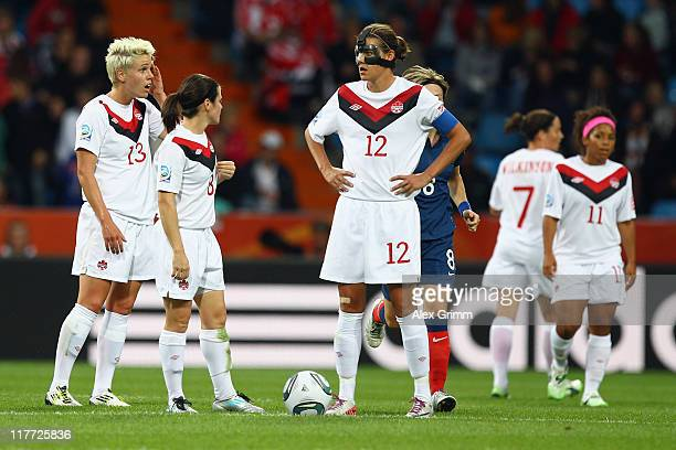 Christine Sinclair Diena Matheson and Sophie Schmidt of Canada react after Camille Abily of France scored her team's third goal during the FIFA...