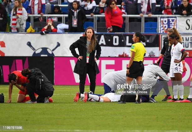 Christine Sinclair of Canada and Ali Krieger of the United States are injured after colliding after going for a header in the second half of the...