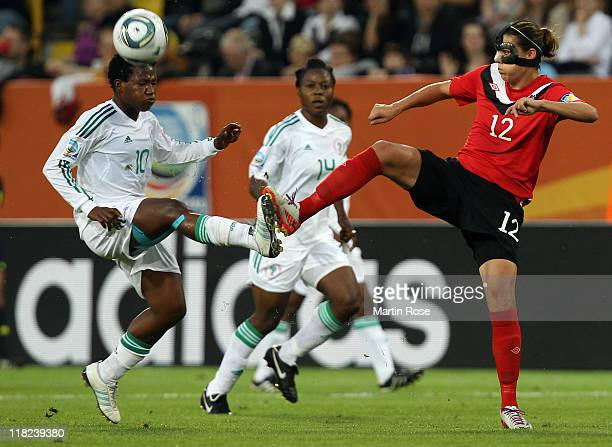 Christine Sinclair of Canada and Rita Chikwelu of Nigeria battle for the ball during the FIFA Women's World Cup 2011 Group A match between Canada and...