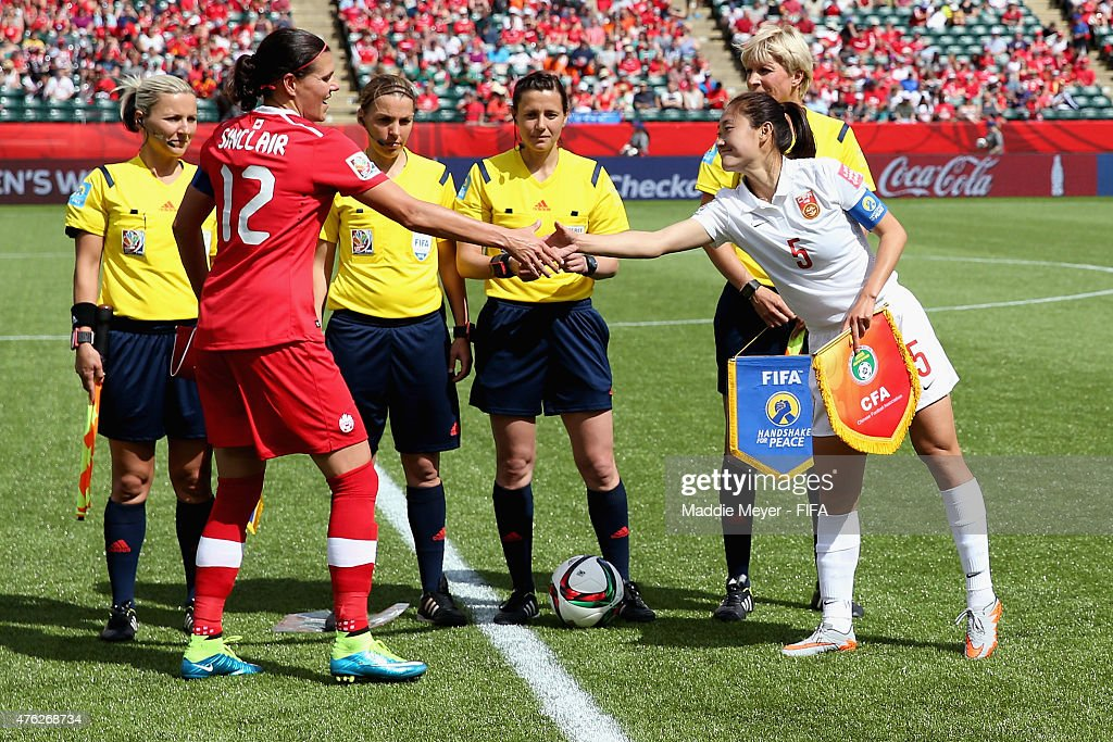 Christine Sinclair #12 of Canada and Wu Haiyan #5 of China PR shake hands prior to the FIFA Women's World Cup Canada 2015 Group A match between Canada and China PR at Commonwealth Stadium on June 6, 2015 in Edmonton, Alberta, Canada.