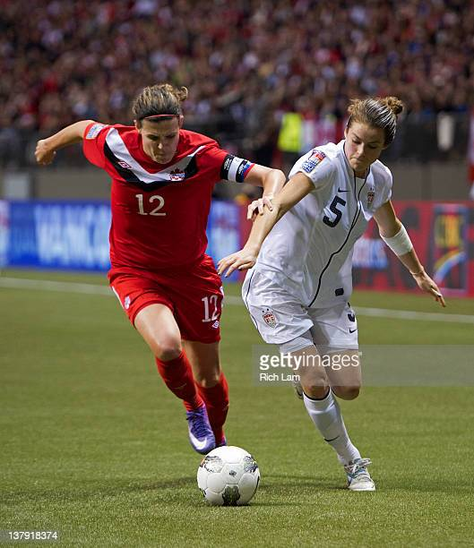 Christine Sinclair of Canada battles with Kelley O'Hara of the United States for the ball during second half of championship action of the 2012...