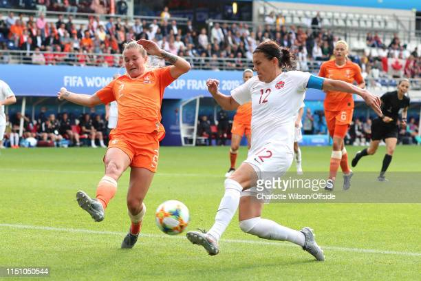 Christine Sinclair of Canada beats Desiree Van Lunteren of the Netherlands to score an equalising goal during the 2019 FIFA Women's World Cup France...
