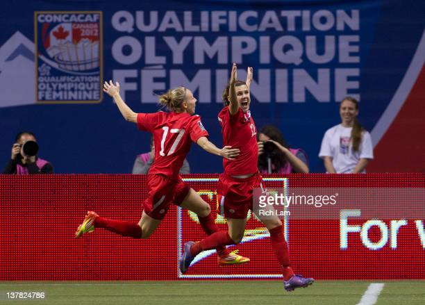 Christine Sinclair of Canada celebrates after scoring her second goal of the game against Mexico with teammate Brittany Timko during the second half...