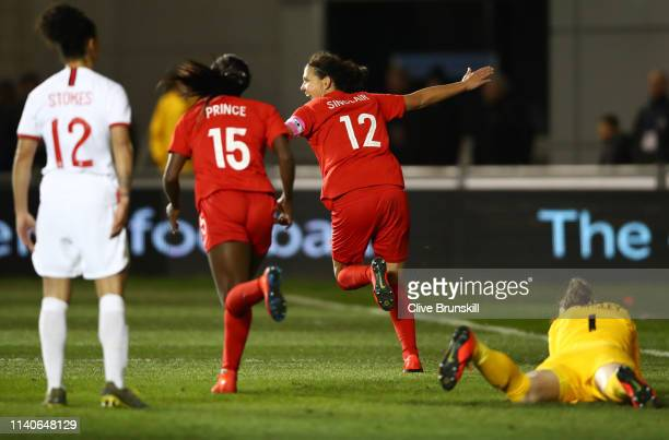 Christine Sinclair of Canada celebrates as she 1scores her team's first goal during the International Friendly between England Women and Canada Women...